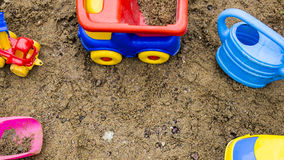 Toys in the sandbox. Watering can, dump truck, shovel Stock Images