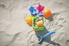 Toys on the sandy beach. Colored children`s toys on the sandy beach on sunny days stock photos