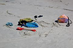 Toys on a sandy beach waiting for their owner. Beach bags and sand toys on a favorite beach while the children are playing in the turf Stock Photo