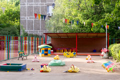 Toys on sandy playground of nursery school Stock Image