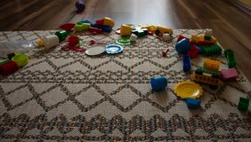 Toys are scattered on the floor royalty free stock photo