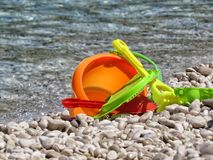 Toys on the sea. A detail of some toy on the sea Stock Photography
