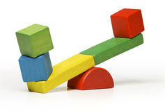 Toys seesaw wooden blocks, teeter totter on white backg