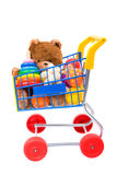 Toys in the shopping cart Royalty Free Stock Image