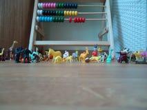 Toys. Small toys gathered on the floor stock photos