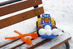 Toys on a snowy bench. Royalty Free Stock Images