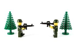 Toys soldiers. Two plastic toys soldiers with weapon on the white background royalty free stock photos