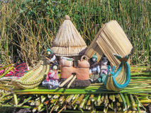 Toys, Souvenirs, and handicrafts made at Uros floating island and village on Lake Titicaca near Puno,  Peru Royalty Free Stock Images