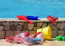 Toys and swimming pool Stock Image