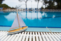 Toys at swimming pool Stock Photos