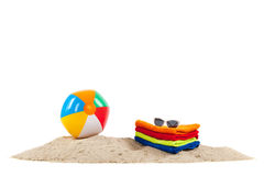 Toys and towels at the beach Stock Photo