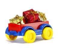 Toys, truck trailer with gifts and toys Royalty Free Stock Photography