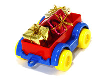 Toys, truck trailer with gifts and toys Royalty Free Stock Photo