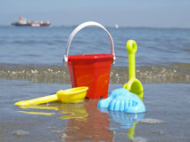 Toys on a wet beach. Different kind of toys on the beach Stock Image