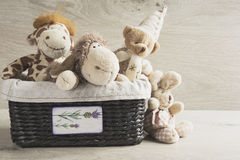 Toys in a wicker basket on the table Stock Image
