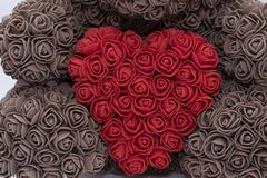 Free Toys With A Red Heart Of Roses. Feast Of St. Valentine, Love. A Brown Bear Holds Stock Images - 144829054