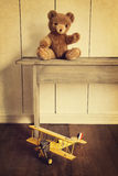 Toys on wooden bench with vintage look. Antique toys on wooden bench with vintage look stock photography