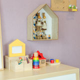Toys on wooden desk with picture frame and shelves on wall Royalty Free Stock Photo