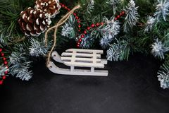 Toys wooden sleigh with presents - preparation and New Year`s Eve stock photo