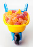 Toywheelbarrow full of sugary jellies Royalty Free Stock Photography
