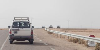 The desert cars expedition on Tunisian road stock images