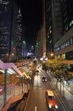 Tráfego da rua de Hong Kong na noite Fotografia de Stock Royalty Free