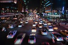 Tráfico chino en la noche Imagenes de archivo
