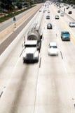 Tráfico de la autopista sin peaje Fotos de archivo libres de regalías