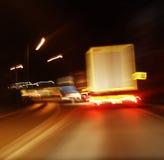Tráfico de la carretera en la noche Fotografía de archivo libre de regalías