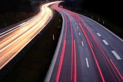 Tráfico de la noche Imagenes de archivo