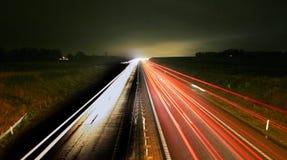 tráfico de la noche de la hora punta foto de archivo libre de regalías