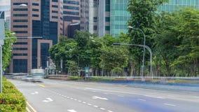 Tráfico de Singapur alrededor del timelapse del centro de ciudad almacen de metraje de vídeo