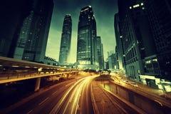 Tráfico en Hong Kong en el tiempo de la puesta del sol Imágenes de archivo libres de regalías