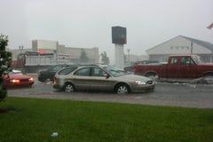 Tráfico en una calle inundada Imagen de archivo libre de regalías