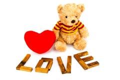 Trä` för ord`-FÖRÄLSKELSE som göras från naturliga materiella bokstäver Valentinbackgroun Royaltyfri Foto
