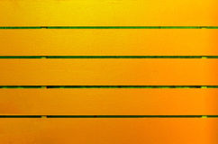 Trä målad guling- och gräsplanbakgrund Arkivbilder