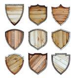 Trä och metallskölden skyddade uppsättningen för stålsymbolstecknet stock illustrationer