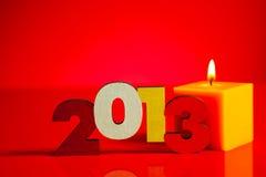 Trä2013 år nummer med ett burning stearinljus Arkivfoto
