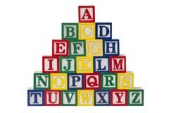 träalfabetblock Arkivbild