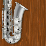 Träbakgrund för abstrakt grunge med saxofonen Arkivfoto