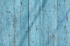 Träbakgrund med blåttmålarfärg, abstrakt textur Fotografering för Bildbyråer
