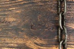 Träbakgrund med kedjan Kopiera utrymme för text Royaltyfri Bild