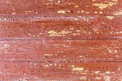 Träbakgrund skalad målarfärg Arkivfoto