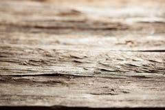 Träbakgrund som textureras med grungeeffekter Royaltyfri Foto