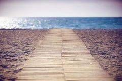 Träbana till havet Royaltyfria Bilder