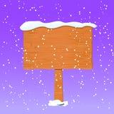 Träbräde i vit snö Arkivbild