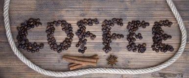 Träbräde med ordkaffe Fotografering för Bildbyråer