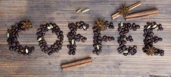 Träbräde med ordkaffe Royaltyfria Foton