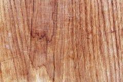 Träbrädeyttersida med skrapor Arkivbild