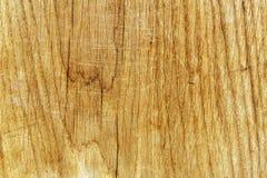 Träbrädeyttersida med skrapor Arkivfoton